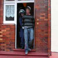 A male is arrested following a raid at an address in Haringey