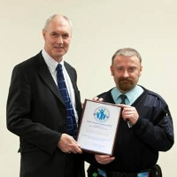 L-R: Willie Armstrong of the Scottish Business Crime Centre presenting to OCS Senior Controller Dean Hutchings