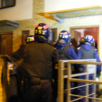Officers on a raid on the Stonebridge Estate