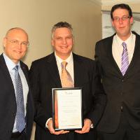 BSIA regional winner Spencer Harbron (centre) with Securitas Country President Brian Riis Neilsen (left) and Securitas account director Stuart Kedward