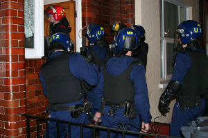 Officers executing a warrant in Haringey