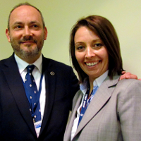 Outgoing Chairman, Mike Bluestone, congratulates Emma Shaw on her appointment as the Security Institute's new Chairman