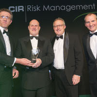 Peter Speight (2nd left) and Mike Topham (3rd left) pick up the award for Physical Guarding at the CIR Risk Management Awards